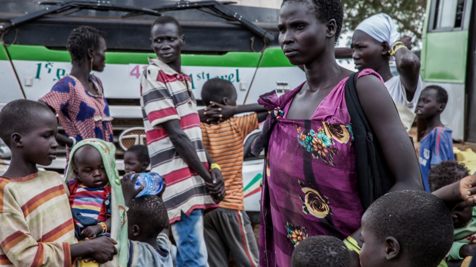 South Sudanese refugee Nyawett, accompanied by 10 children, shortly after reaching Gure Shombola camp, in Ethiopia.