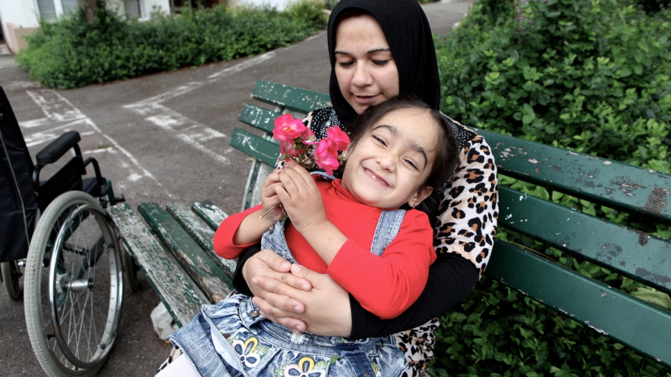 Syrian refugee Aya, 4, has spina bifida, meaning she is paralyzed from the waist down. She has been resettled in Laval, north-west France with her family.