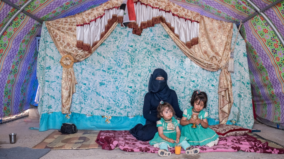 Asmaa Mahmood, 27, and her two children Rimah, 4, and Bedoor, 2.