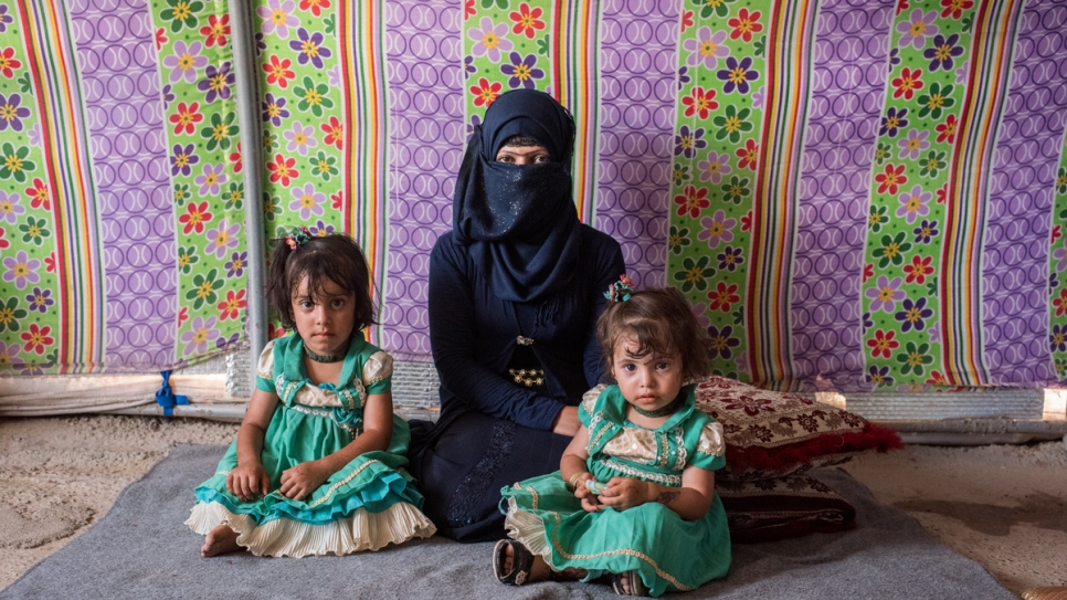 Asmaa's husband was recently killed and she is now raising her children in the camp.