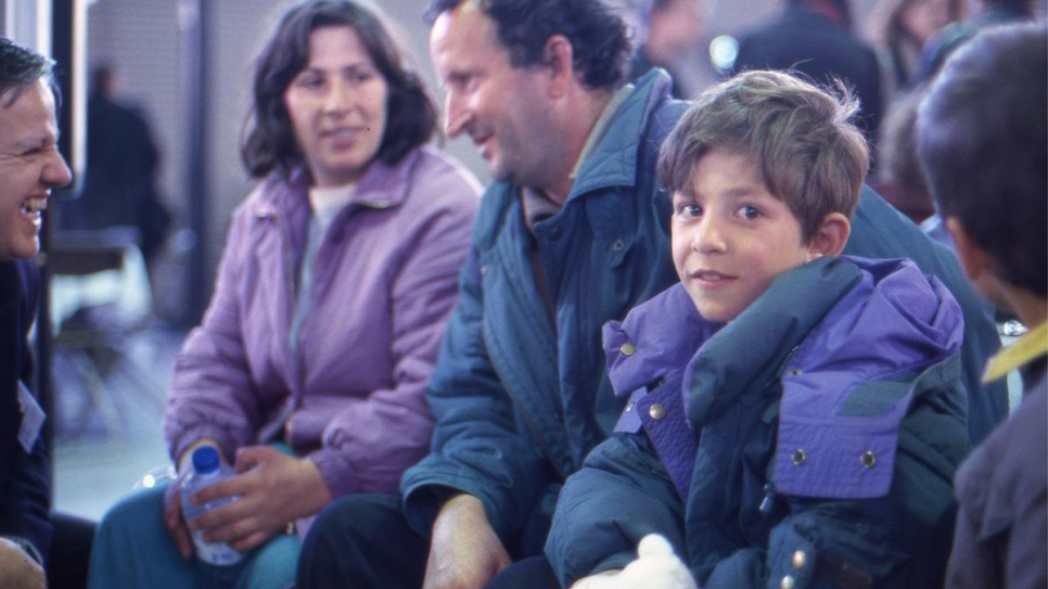 Refugees from Kosovo* temporarily evacuated from the former Yugoslav Republic of Macedonia arrive at the Roissy airport, in Paris, in April 1999.