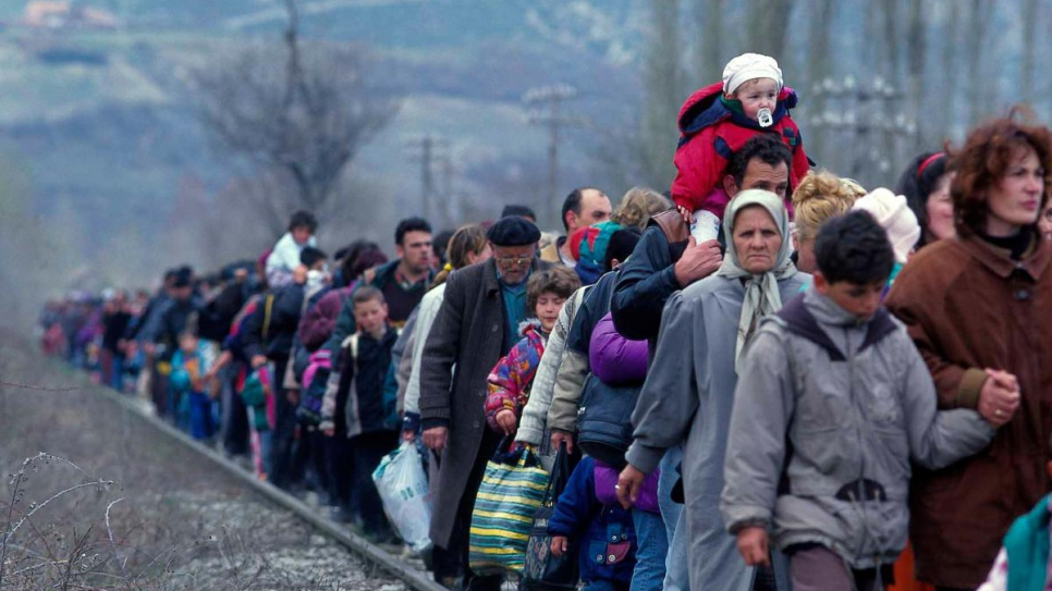 Refugees from Kosovo* arrive in Blace, in the former Yugoslav Republic of Macedonia, in March 1999.