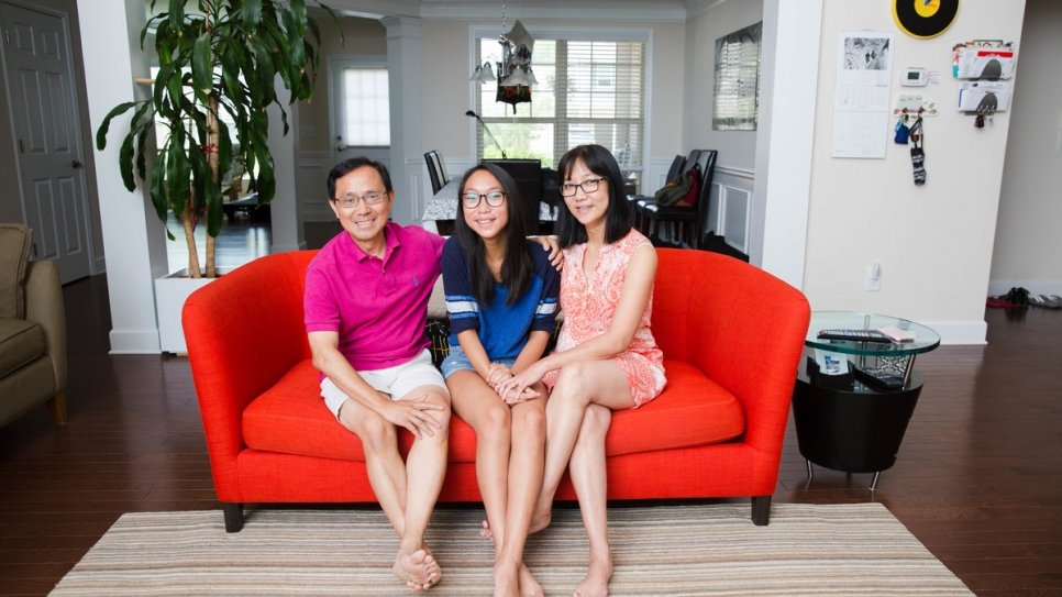 Thanh Dang with his daughter, Thien-An, 13, and wife, Lan Ho, at home in Suwanee, Georgia. A refugee from Viet Nam, he was resettled to the United States under an international agreement.