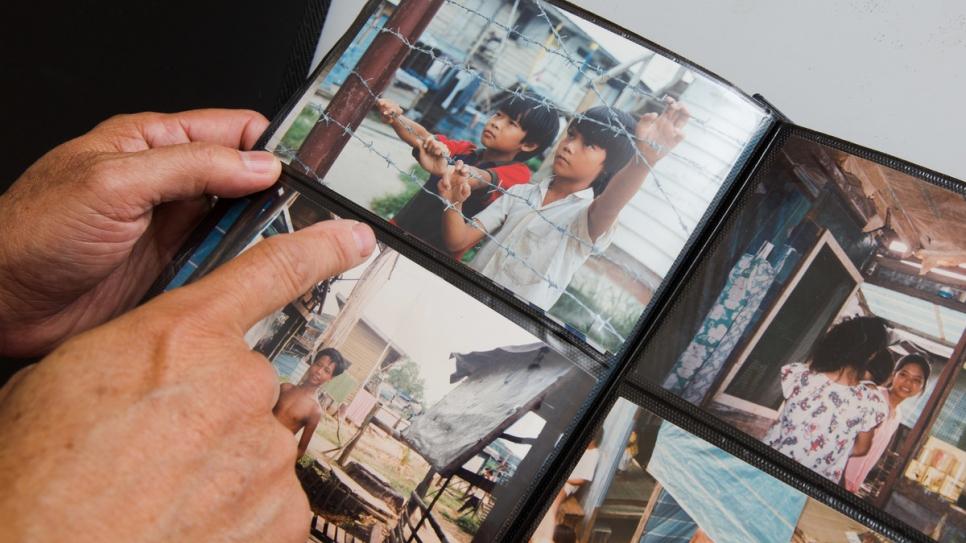 Thanh Dang shows a photograph from his three plus years at Galang refugee camp in Indonesia.