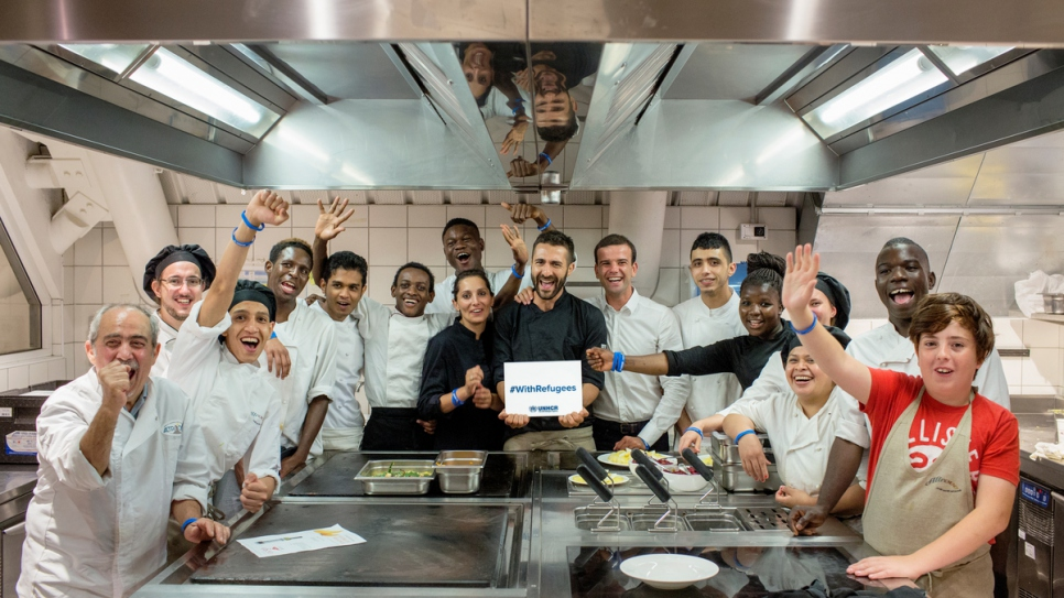 Refugee chefs and their Italian counterparts at Eataly restaurant in Rome.