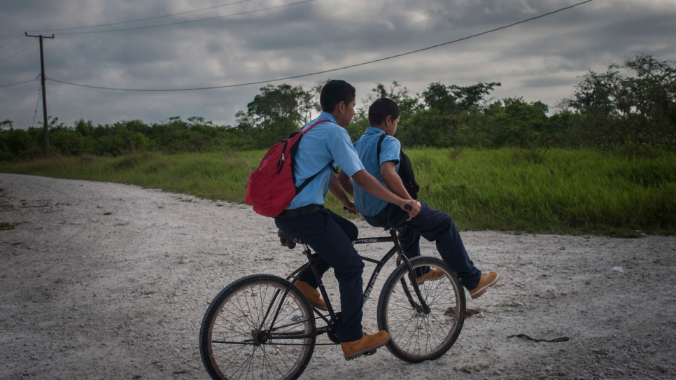 Ulises Menendez, 15, and his 11-year-old brother Juan Roberto on their way to school in the Valley of Peace.