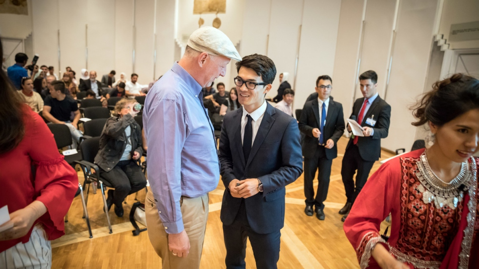 Mojtaba Tavakoli talks to Bernhard Wimmer at a prize-giving organised by the Association of Afghan Pupils and Students at the Ministry of Transport, Innovation and Technology in Vienna.