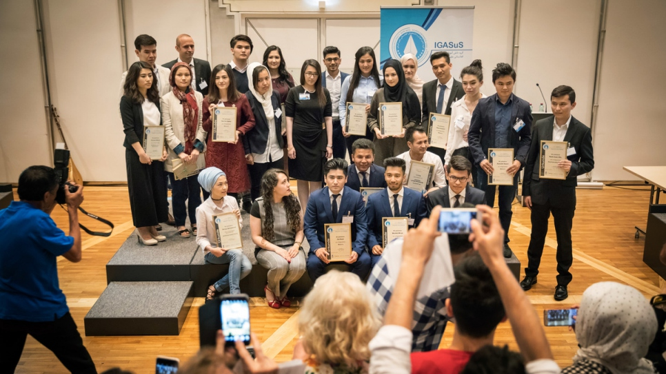 Award-winners display their certificates at a ceremony organised by the Association of Afghan Pupils and Students in Vienna.
