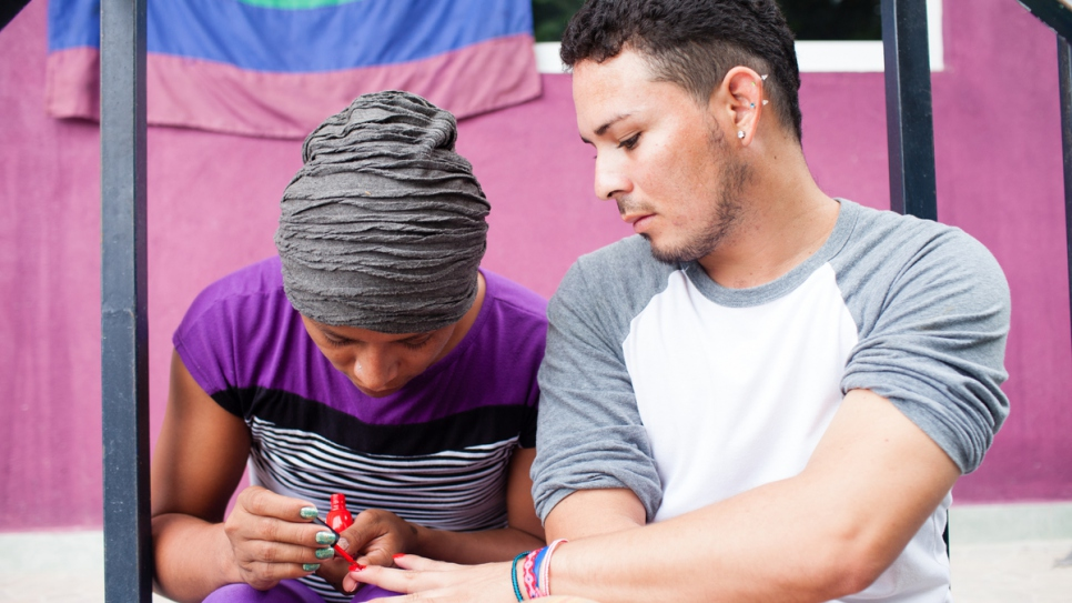 Carlos* and Electra*, who are LGBTI refugees, paint their nails at La 72, a shelter in Tenosique, Mexico. (*Names changed for protection reasons)