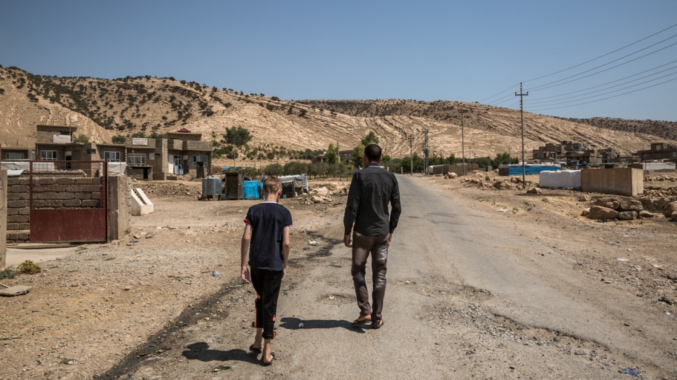 Hadi and his nephew Emad take a walk in the village where they stayed in Dohuk, Kurdistan Region of Iraq.
