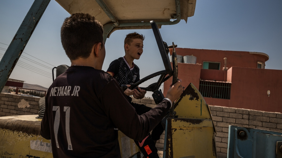 Emad plays on a tractor in Dohuk, the Kurdistan Region of Iraq.