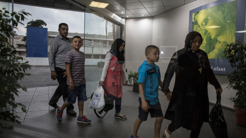 Accompanied by their family, Mohamed and Issam arrive at the Sacre Coeur Hospital in Hazmieh, near Beirut.