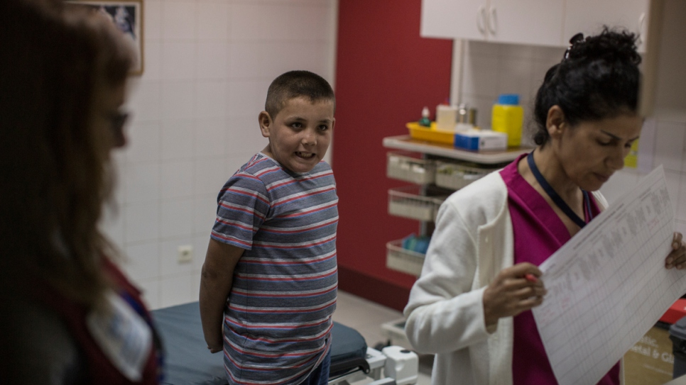 Mohamed  waits to get his height and weight checked at the Sacre Coeur Hospital in Hazmieh.