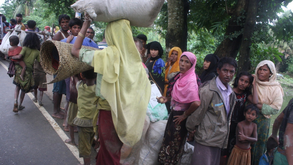 Rohingya refugees arrive in Bangladesh after crossing the border with Myanmar.