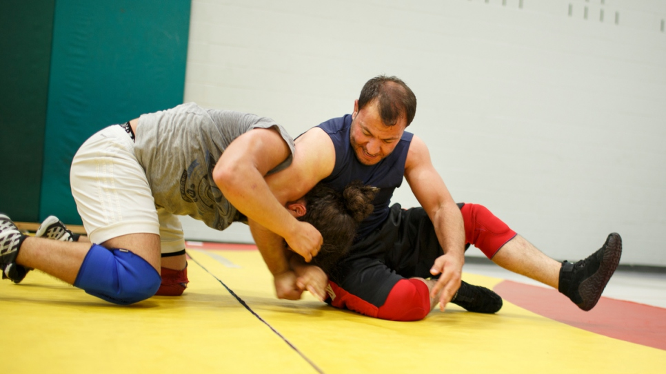 Mohammed teaches students at the National Capital Wrestling Club.