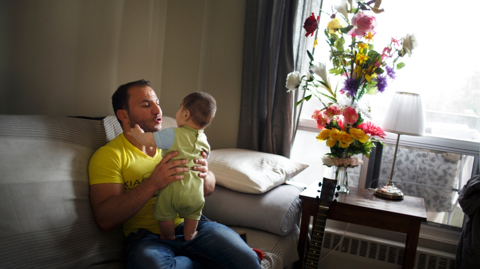 Mohammed with his son Tajaldeen in their new home in Ottawa, Canada.
