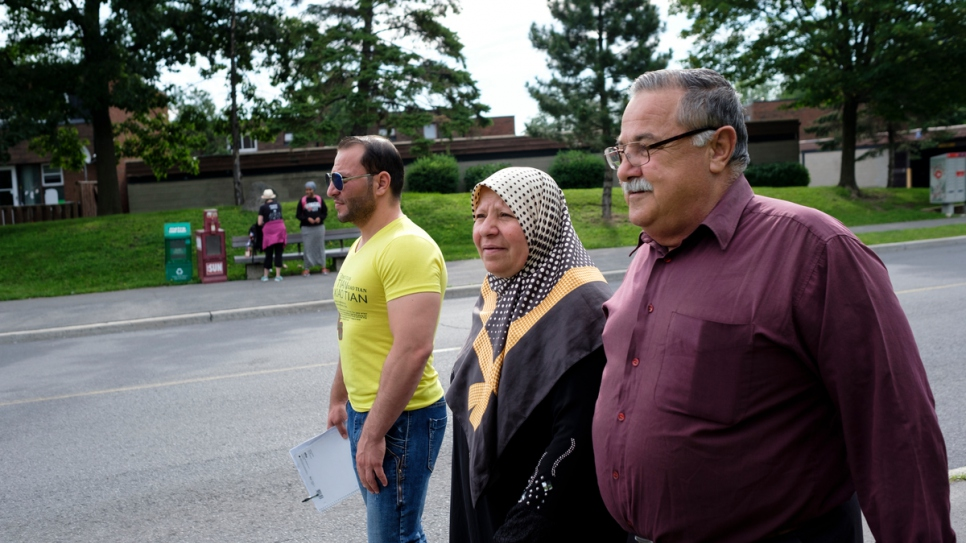 Mohammed walks to English class with his mother Jameeleh and father Mansoor.