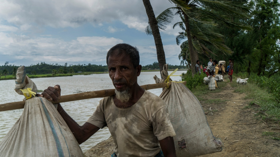 A Rohingya refugee soon after crossing into Bangladesh from Myanmar near Whaikhyang, Bangladesh.