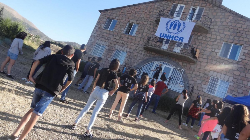 Displaced and refugee youth take part in morning exercises.