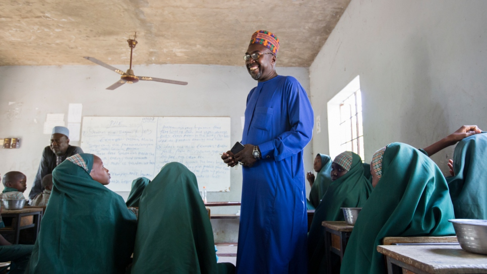 Mustapha talks to students in one of the junior classes of his Future Prowess Islamic Foundation School in Maiduguri, Nigeria.