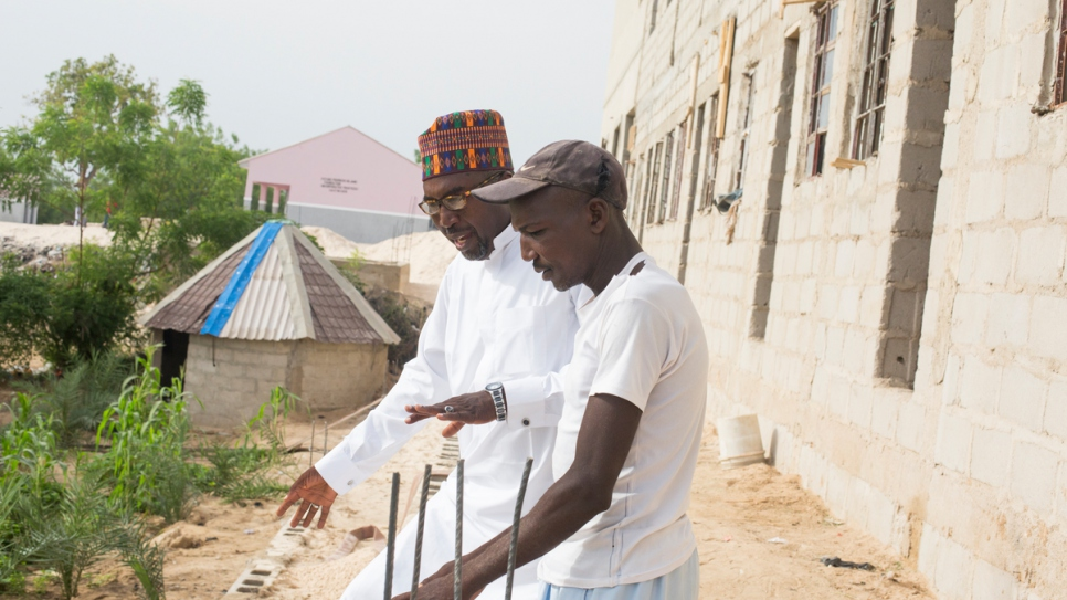 Mustapha inspects the construction of a third school he is now building on the banks of the River Gadabul in Maiduguri. The school will enrol mature students who have missed out on their education due to conflict.