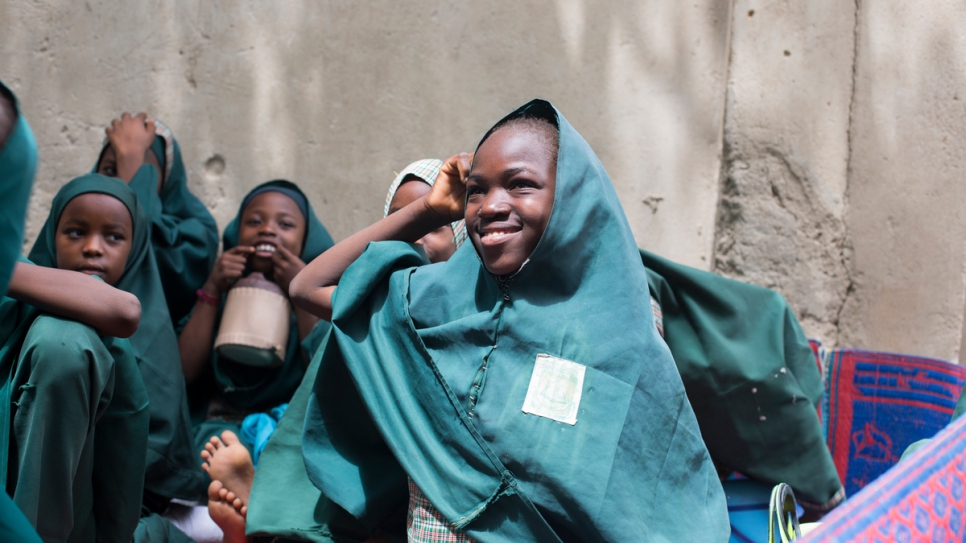Hauwa Madu, 13, whose father was killed by Boko Haram, has found happiness again at school.