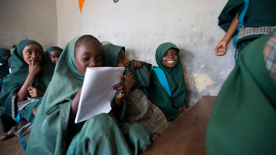 Maryam Goni Umar, 6, reads to delighted class mates at the first school Nansen Award winner Mustapha set up in Maiduguri.