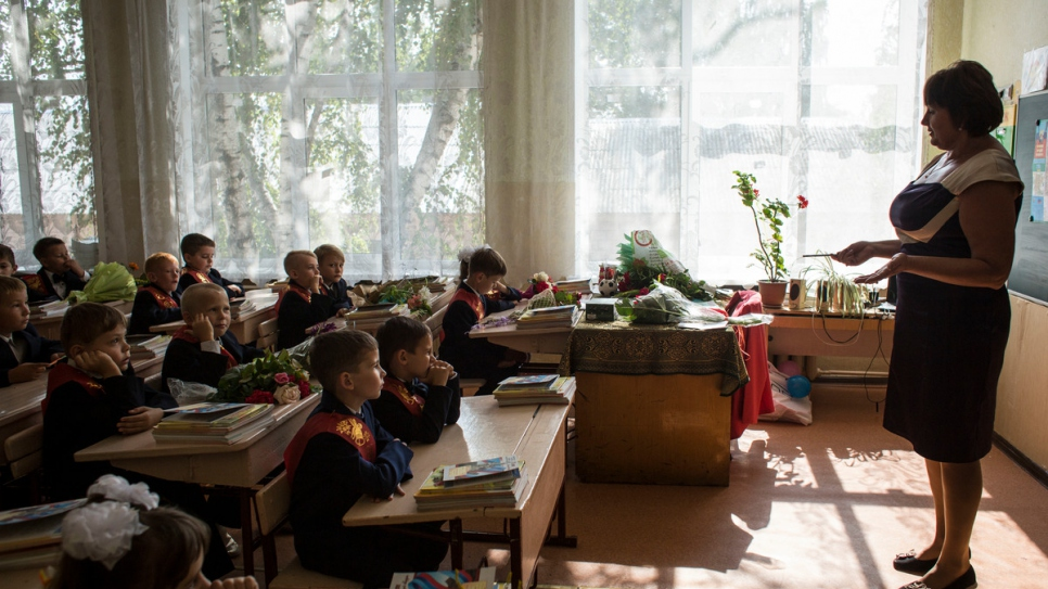 Students enjoy their first lesson at the reconstructed school in Luhansk.