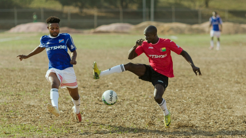 The Democratic Republic of Congo (in blue) and Guinea-Bissau (in red) compete in the first round of the Refugees World Cup in CERET Park, Sao Paulo, Brazil.