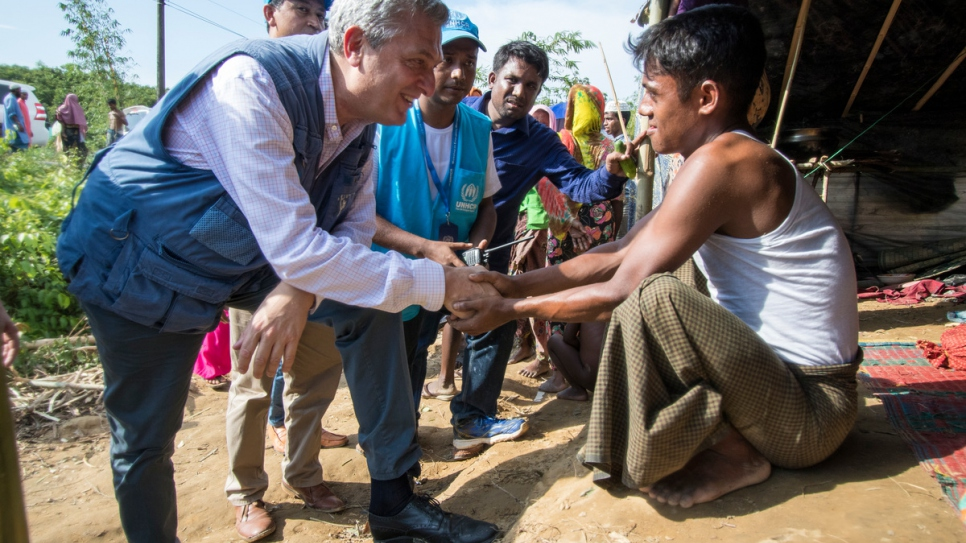 UNHCR High Commissioner Filippo Grandi talks to a young Rohingya man at Kutupalong settlement in Cox's Bazar, Bangladesh.