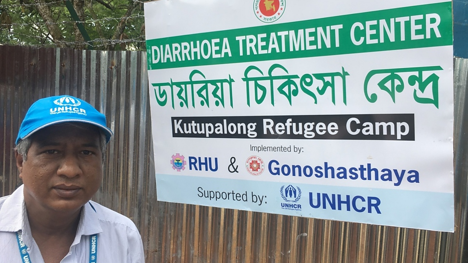 Taimur Hasan stands at the entrance to a rehydration centre to treat refugees withe severe diarrhoea at Kutupalong refugee settlement in Bangladesh, October 2017.