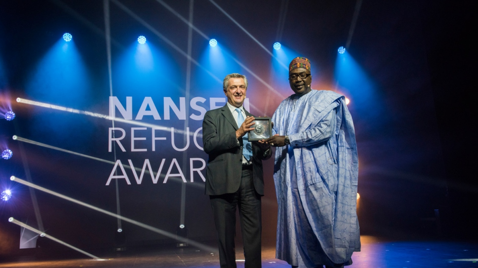 UN High Commissioner for Refugees Filippo Grandi presents the 2017 Nansen Refugee Award to Zannah Mustapha.