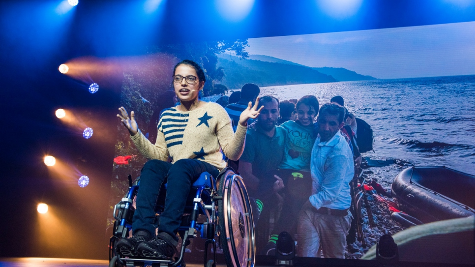 Nujeen Mustafa, who made the dangerous journey from Syria to Germany in a wheelchair, addresses the audience.