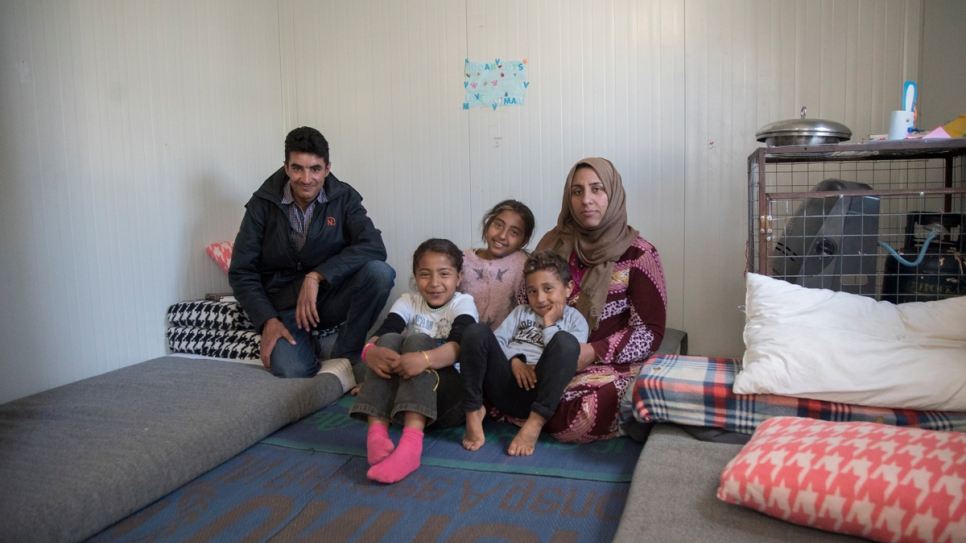 A Syrian family inside their prefabricated container installed by UNHCR at Kara Tepe, in Lesvos, Greece. Over 5,000 refugees and migrants have found shelter in 1,000 prefabricated houses installed by UNHCR across Greece.