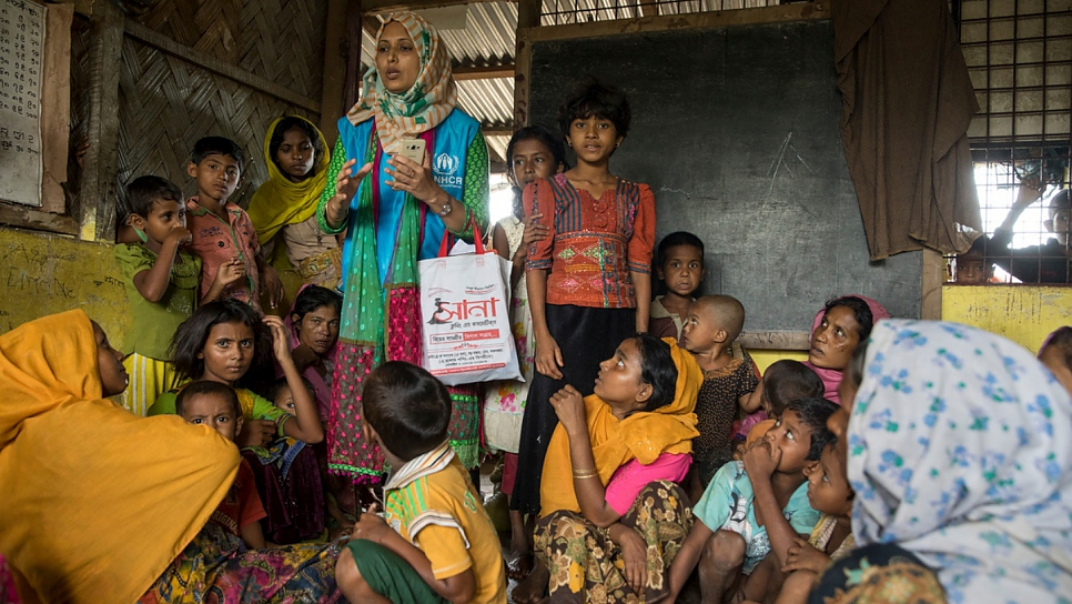Shirin Aktar talks to a group of Rohingya children who are being relocated at Kutupalong Refugee Camp, Bangladesh.