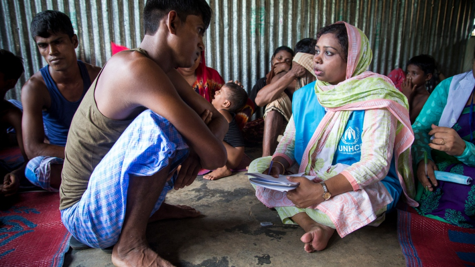 Mahmuda talks with Nurus Salam, 22, a Rohingya boat wreck survivor who lost relatives when their boat capsized on Inani Beach near Cox's Bazar, Bangladesh.