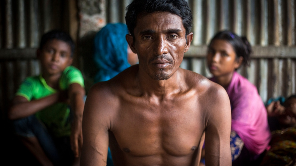 A Rohingya boat wreck survivor who lost relatives when his boat capsized on Inani Beach near Cox's Bazar receives counselling at Kutupalong refugee camp in Bangladesh.