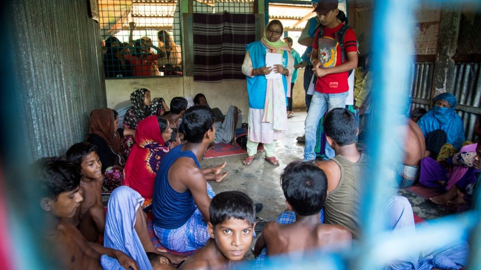 Mahmuda talks to Rohingya boat wreck survivors who lost relatives when their boat capsized on Inani Beach near Cox's Bazar, Bangladesh.