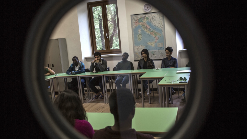 Emmanuel, in the first semester of his first year at UWC Adriatic, and his classmates attend a lecture held by UNHCR reporter Helen Womack.