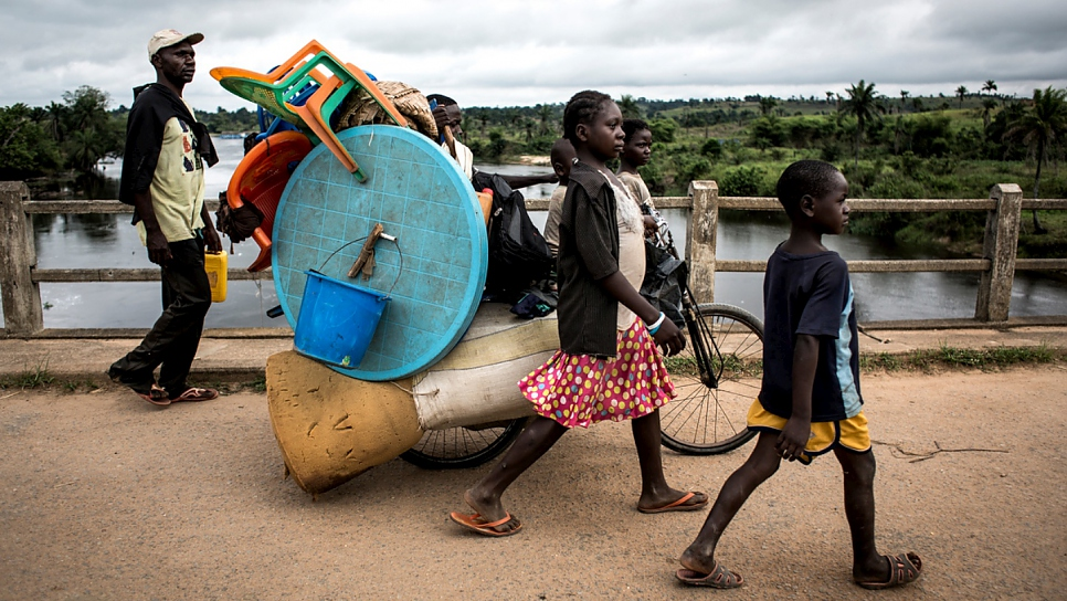 A family flee violence in Kamonia, Kasai Province, the Democratic Republic of the Congo.