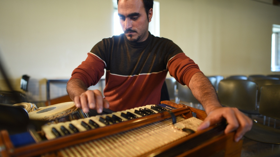 Walid Rafi, from Afghanistan, plays the tabla and harmonium with the Orpheus XXI orchestra at the UNESCO-listed Royal Saltworks cultural venue.