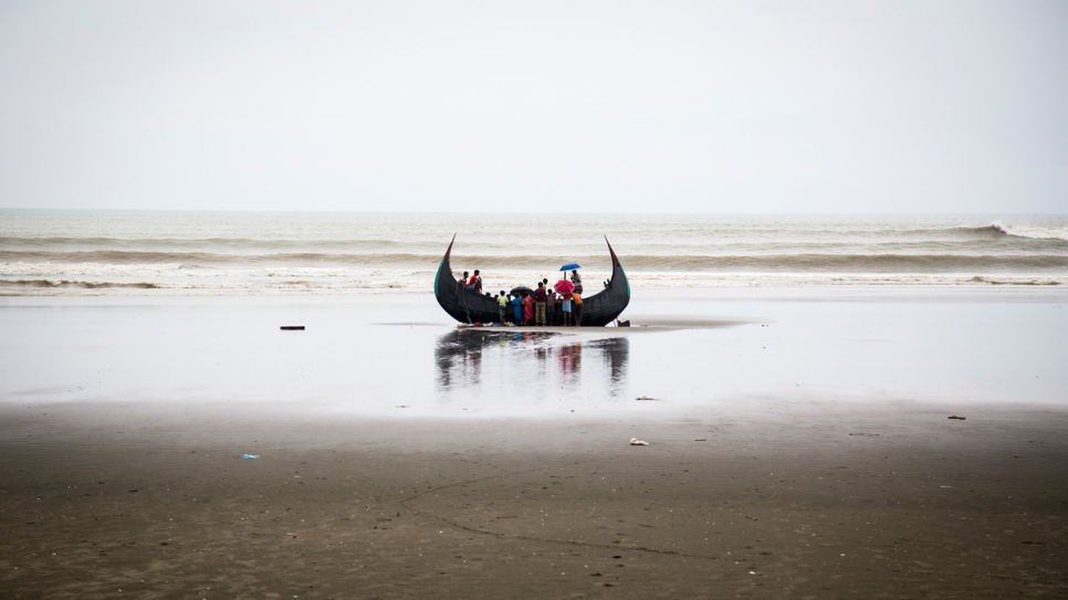At least four Rohingya refugees died when their boat capsized close to shore in southern Bangladesh.