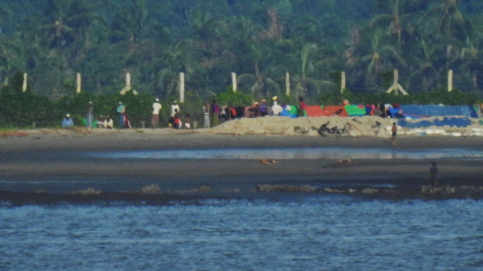 The recent boat arrivals consistently say that thousands more people are waiting on Myanmar's shores in deteriorating conditions.