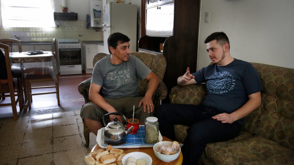 Tony Kassab (right) chats to his uncle, Farhan Kassab, who moved to Argentina from Homs, Syria, in 1998 and now runs a chain of Middle Eastern takeaway restaurants.