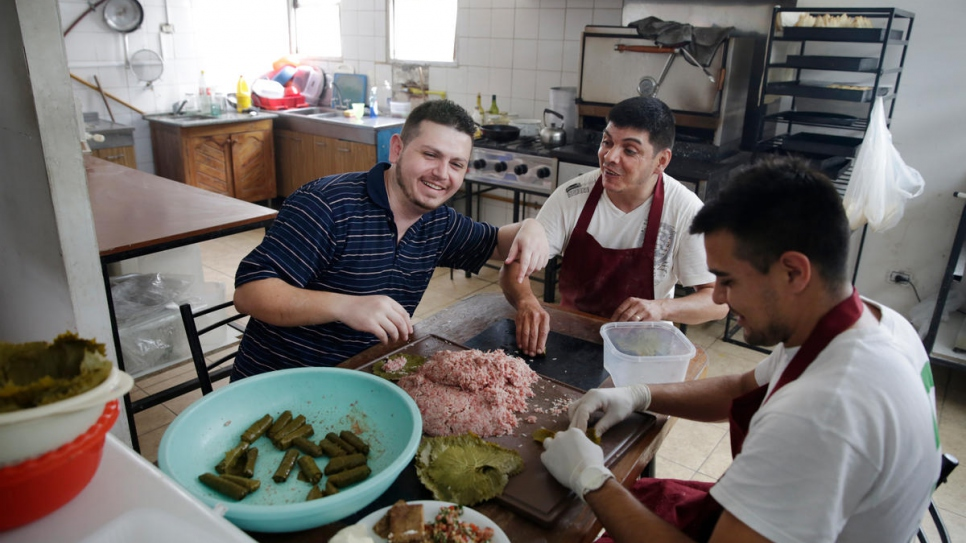 """People here don't have much of an idea about Arab food, so it's a chance to show my culture,"" says Tony (left) who works in his uncle's restaurant as manager and cook."
