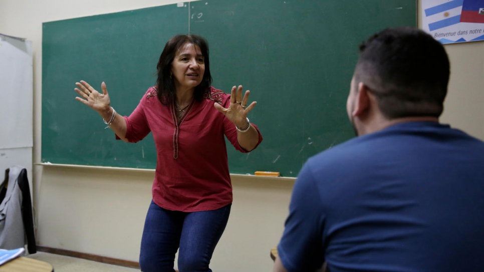 Tony Kassab, from Syria, takes Spanish classes at the National University of Córdoba with teacher Verónica Segui.