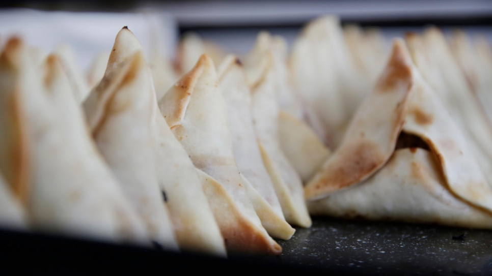 Middle Eastern empanadas prepared by Tony are left to cool after being taken out of the oven.