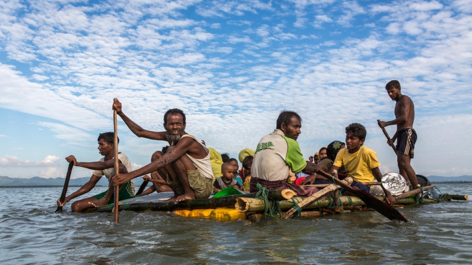 Hundreds of Rohingya refugees cross the Naf River on makeshift rafts fleeing their homeland in Myanmar towards Teknaf, in Bangladesh.