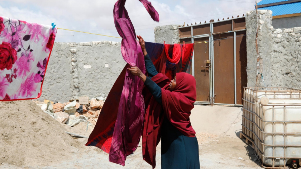 The dyed fabric is hung to dry before being taken to Kismayo market.