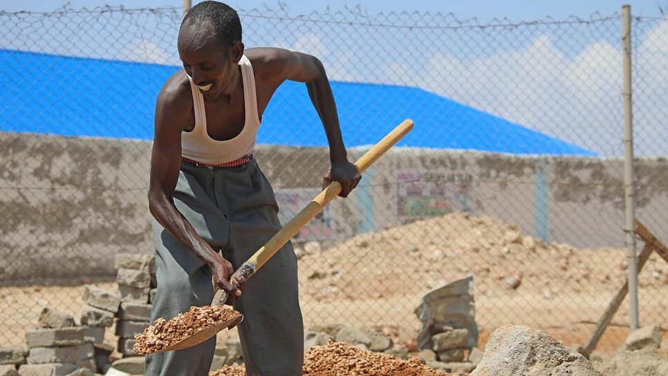 Mohamed also does part-time construction work to support his family since returning to Somalia.